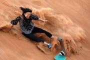 Sand Boarding - Sand Surfing Desert Safari Dubai